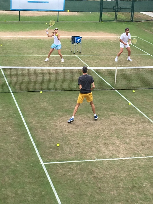 Martina Hingis and Patrick Mouratoglou instructing a game of doubles